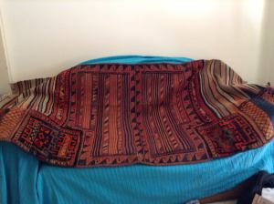 A Camel Bag as Rug